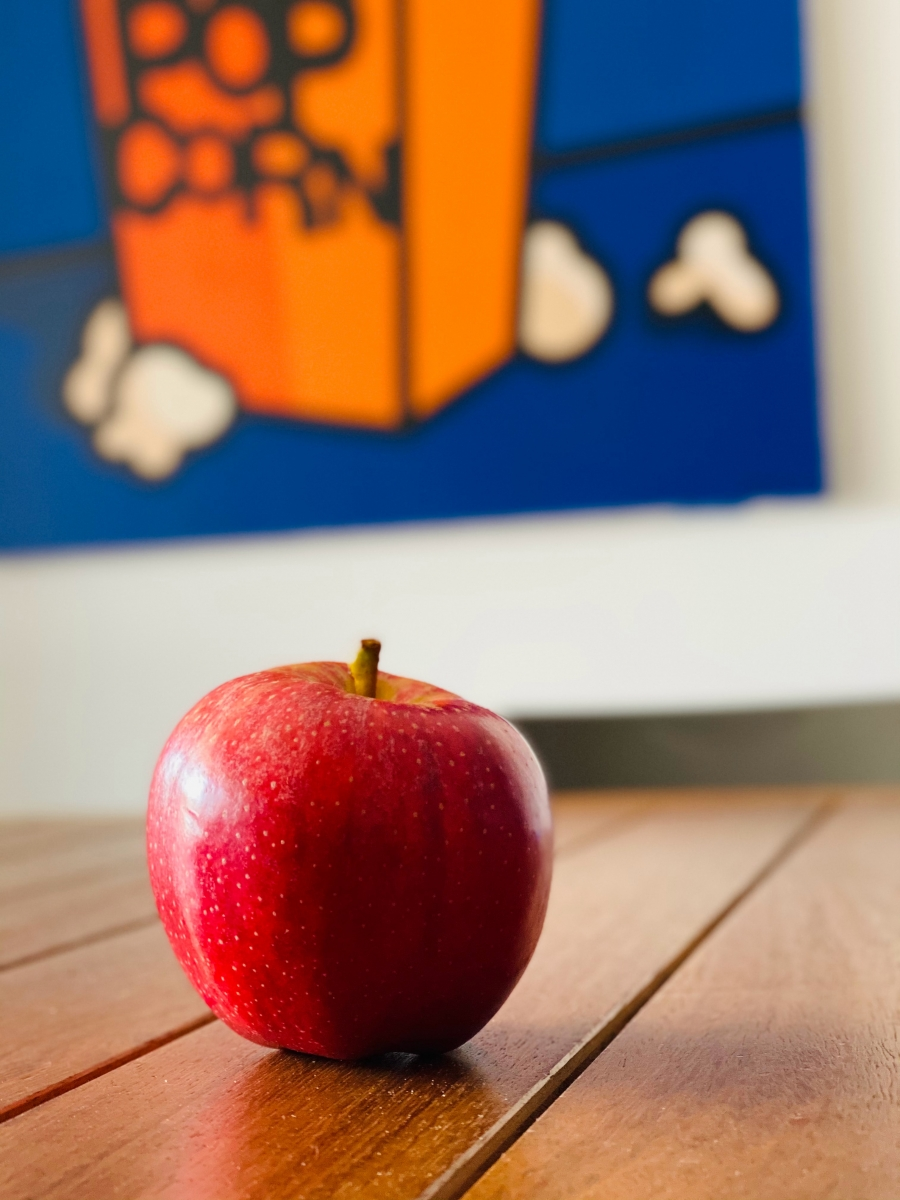 image of an apple on desk