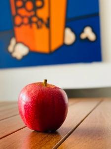 image of an apple on desk